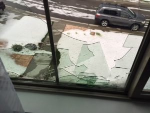 broken window from baseball sized hail in Highlands Ranch, CO.